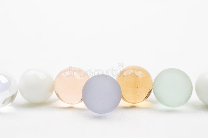 Exponeringsglasmarmor i pastellfärgade färger arkivfoto