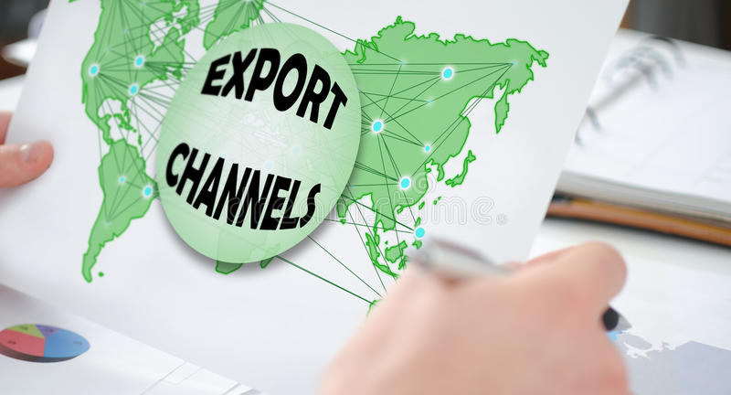 Export channels concept on a paper. Hands holding a paper showing an export channels concept stock image