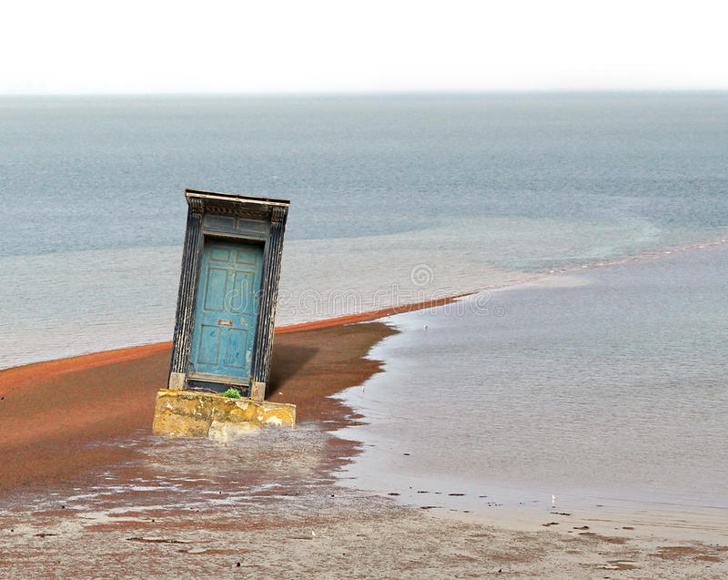 Exposed door at low tide abstract stock image