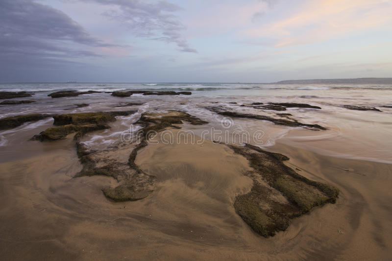 Exposed rocks and sunset with rushing water royalty free stock images