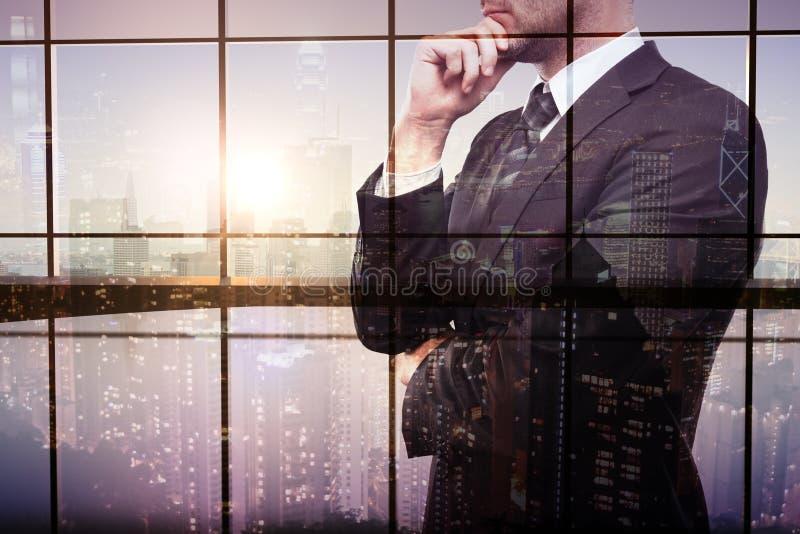 Exposição dobro do homem de negócios pensativo foto de stock royalty free