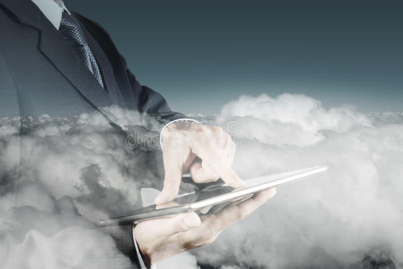 Exposición doble de la mano del hombre de negocios usando la tableta digital imagen de archivo libre de regalías