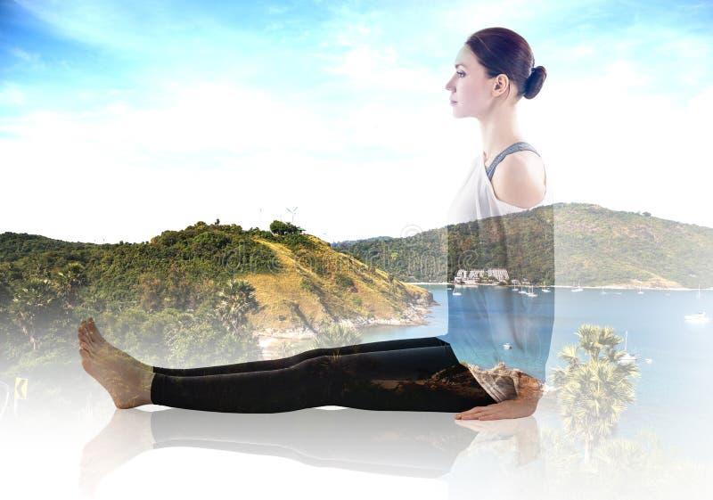 Exposición doble de la mujer que hace ejercicio de la yoga imagen de archivo libre de regalías