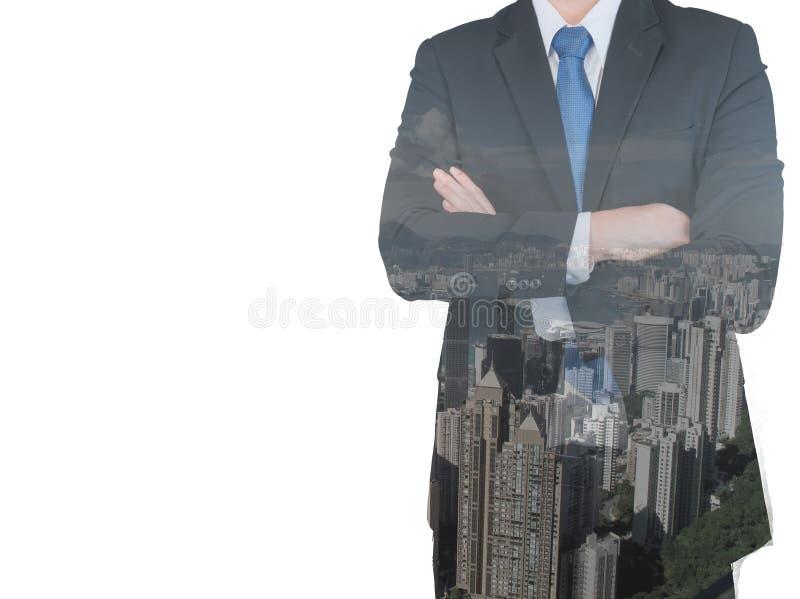 Exposición doble del hombre de negocios y de la ciudad foto de archivo