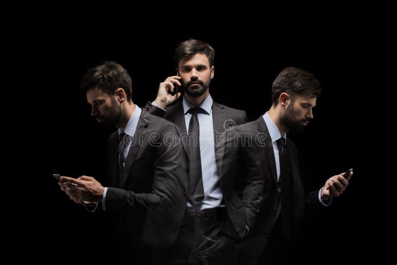 Exposición múltiple del hombre de negocios ocupado usando smartphone fotografía de archivo libre de regalías