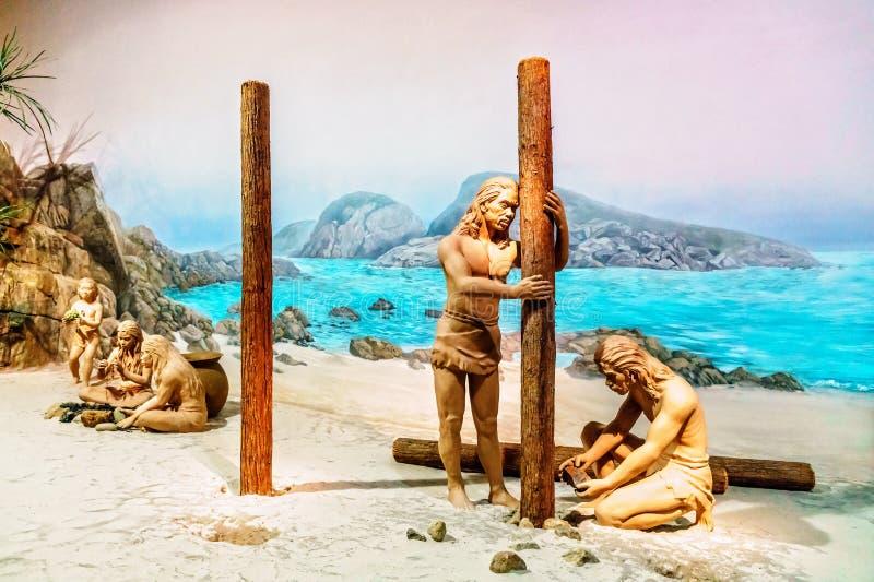 Expositie in Hong Kong Museum van het primeaval leven van Geschiedenisvertoningen van primitieve Aziatische mensen in natuurlijk  stock foto