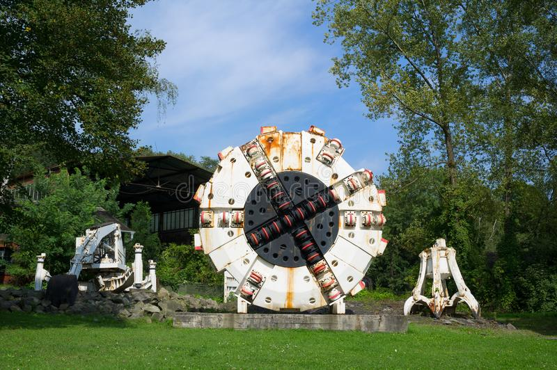 Landek park, Ostrava. Exposition of heavy mining equipment in the nature. Miners and rock cutter combines are on the green grass in the Landek park, Ostrava stock photos
