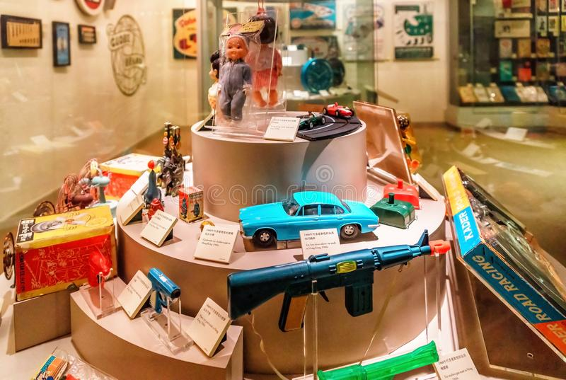 Exposition of old children toys in Hong Kong Museum of History. Various historic toy exhibits displayed in museum. Hong Kong, China - January 20, 2016 stock photography