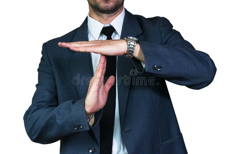 Expositions d'homme d'affaires faisant le geste de coupure de temps photo stock