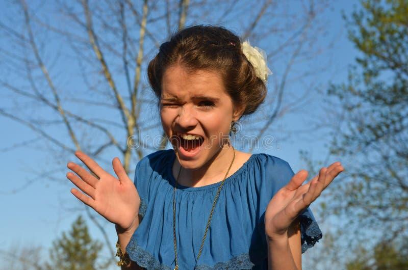 Expresión del adolescente de la cara fotografía de archivo