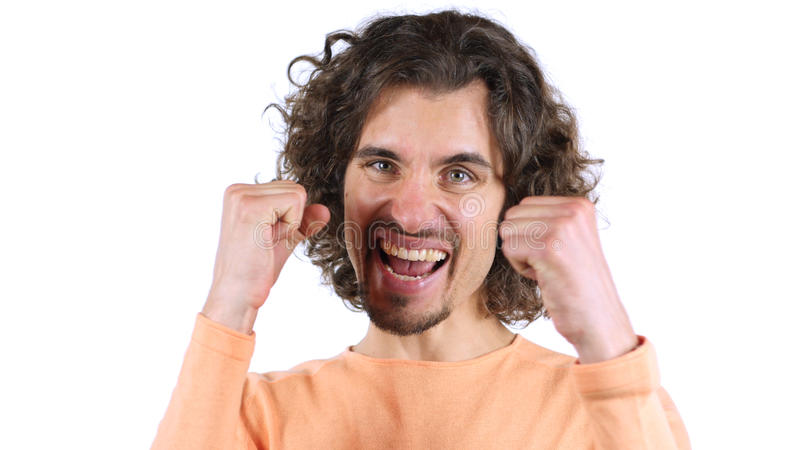 Expresión del entusiasmo del éxito, hombre con los pelos rizados foto de archivo