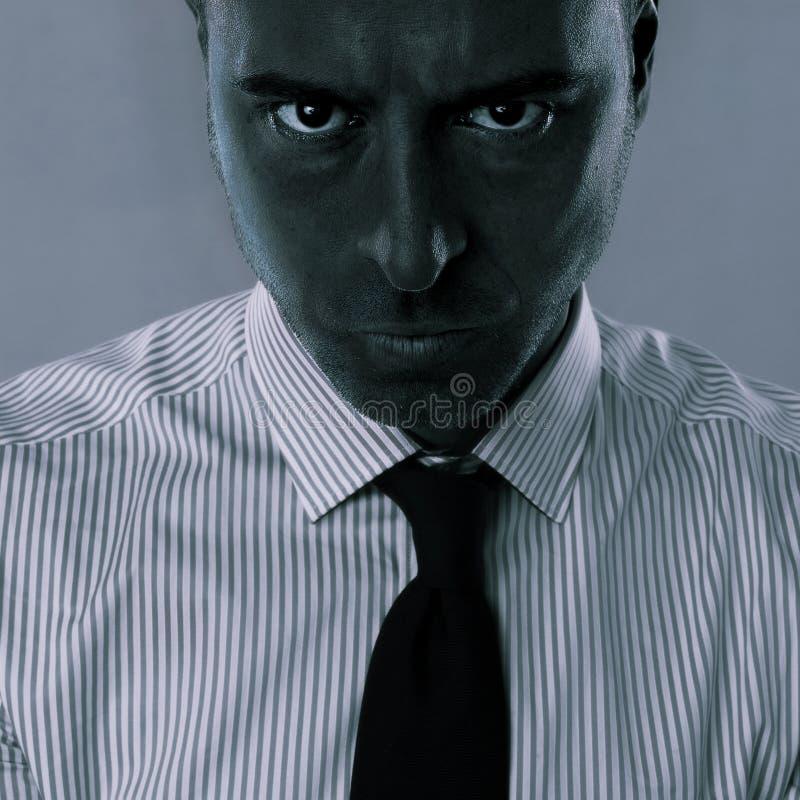 Expresión enojada en la cara del hombre de negocios fotos de archivo