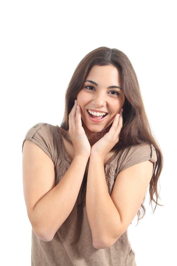 Expresión eufórica de la mujer con sus manos en la cara foto de archivo
