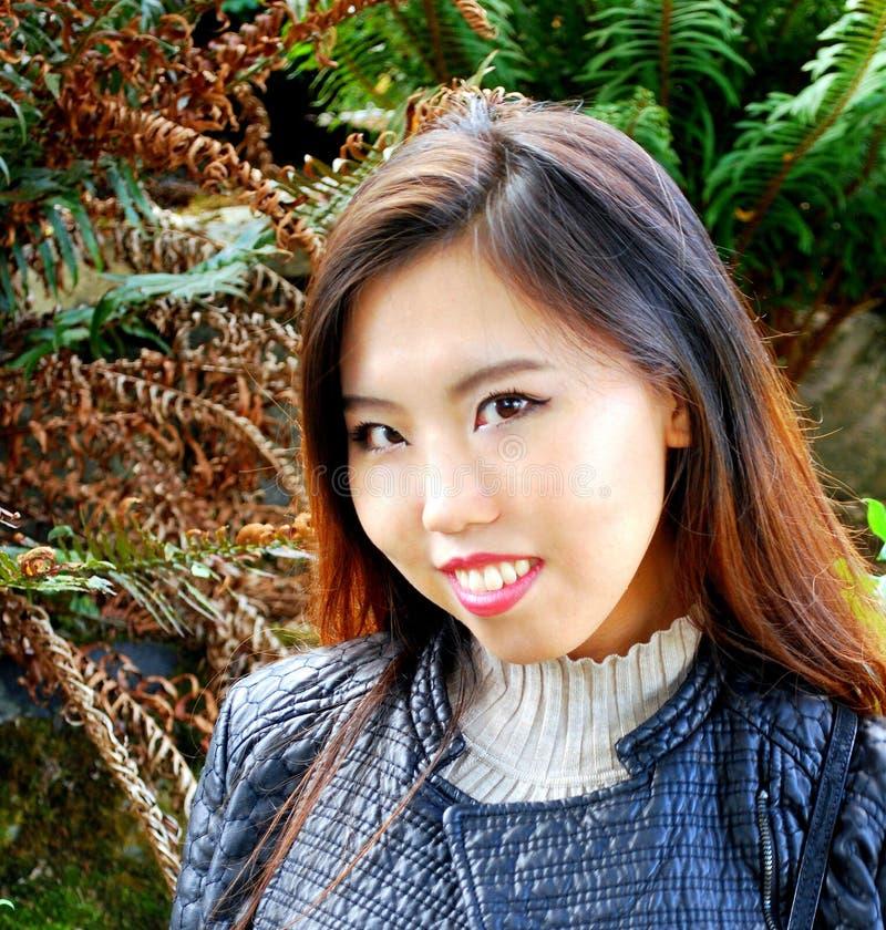 Expresiones femeninas asiáticas de la belleza imagenes de archivo