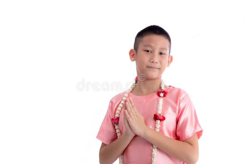 Expressão asiática Sawasdee da boa vinda do menino fotografia de stock