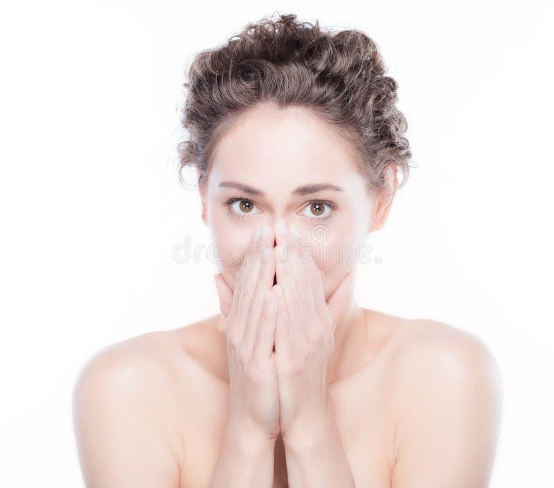 Expressão assustado de sorriso nova da cara da mulher imagens de stock