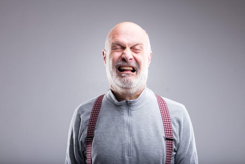 Expressão de rasgo exagerado do ancião fotografia de stock
