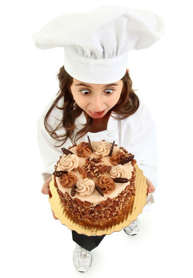 Expressão engraçada uniforme do cozinheiro chefe da criança fotografia de stock royalty free