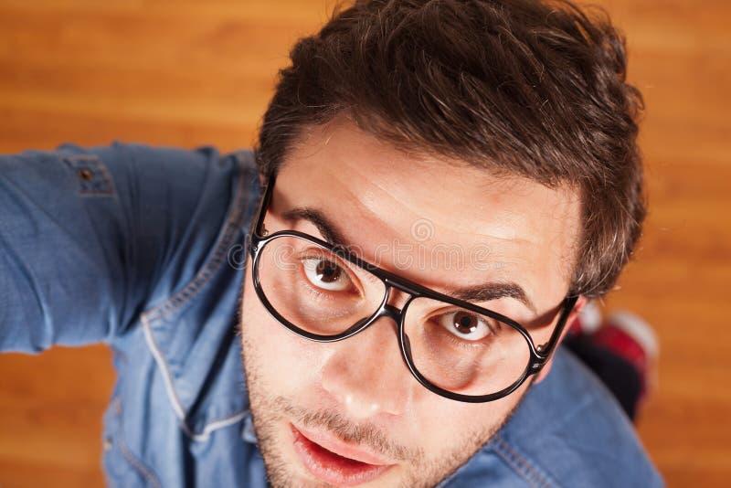 Expressão facial de homem novo imagens de stock royalty free