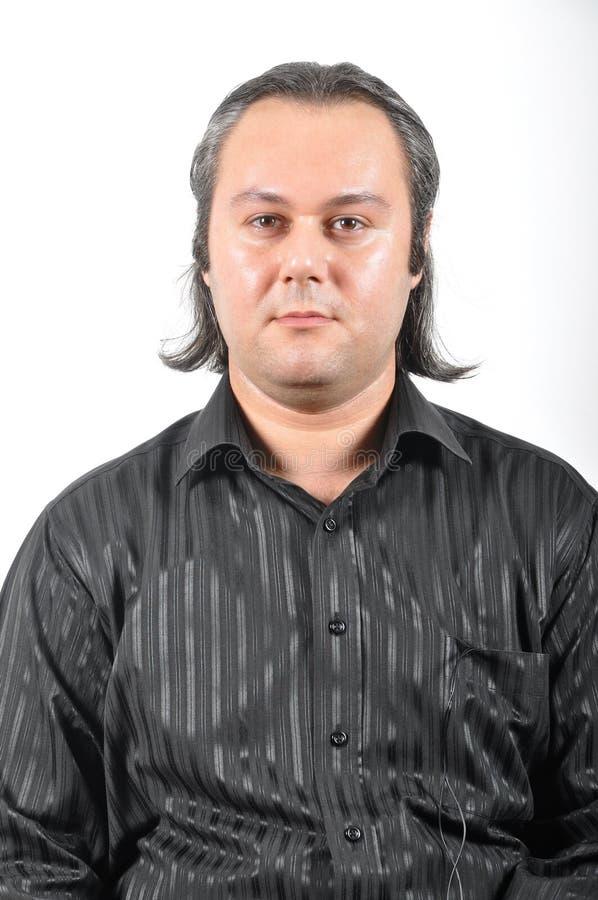 Expressão facial do homem de cabelos compridos fotografia de stock