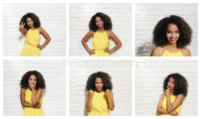 Expressões faciais da mulher negra nova na parede de tijolo foto de stock