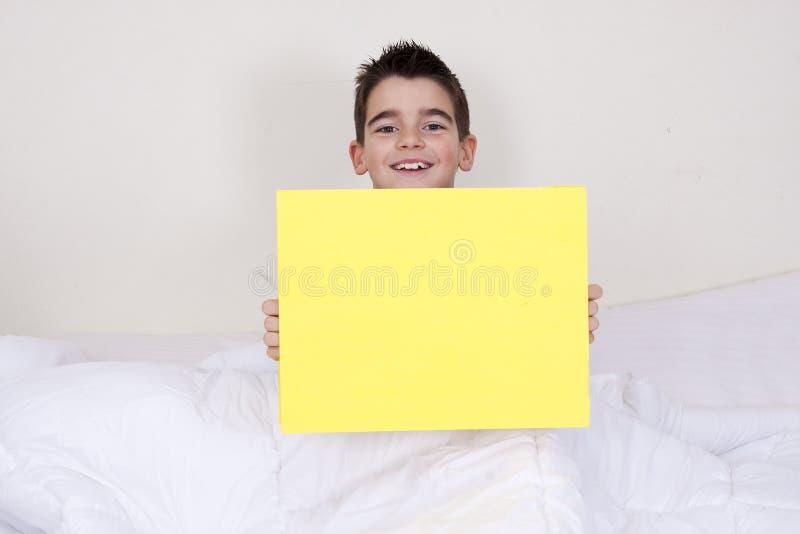 Expressões na cama imagens de stock royalty free