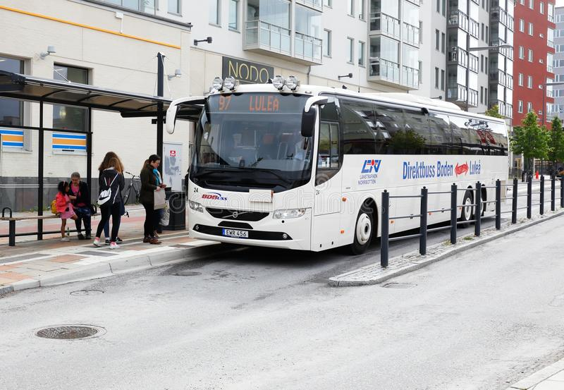 Express bus service in Boden. Boden, Sweden - June 18, 2018: A white public transport express bus in traffic on line 97 with destination Lulea at the stop on the stock images