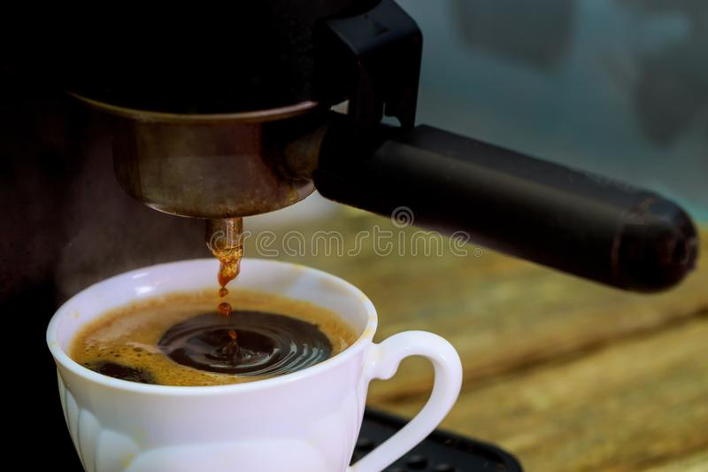 Express coffee from the coffee maker professional coffee maker stock photo