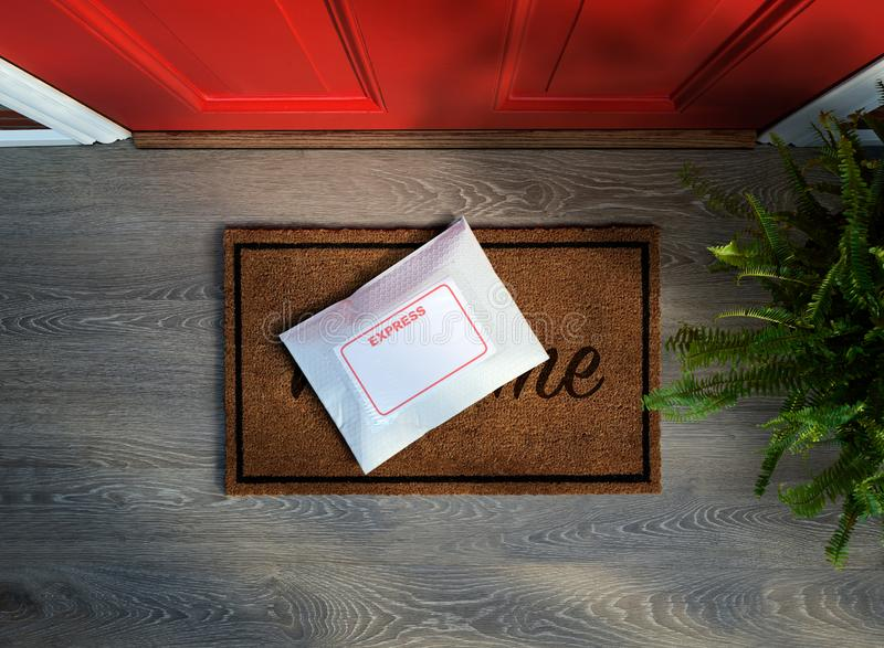Express courier package delivered outside front door. Express courier package delivered outside residential front door. Overhead view. Copy space royalty free stock images
