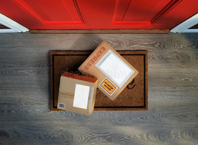Express box delivered outside front door. Boxes delivered to the door, easy to steal. Overhead view. Add your own copy to the labels royalty free stock photos