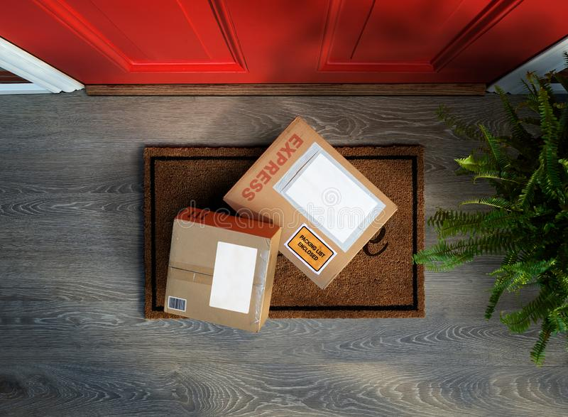 Express delivery boxes delivered outside front door are easy to steal. Express delivery boxes outside front door are easy to steal. Overhead view. Add your own royalty free stock photos
