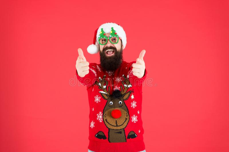Express positivity. merry christmas. hipster man reindeer on knitted sweater. winter holiday. cold season clothes. happy royalty free stock photo