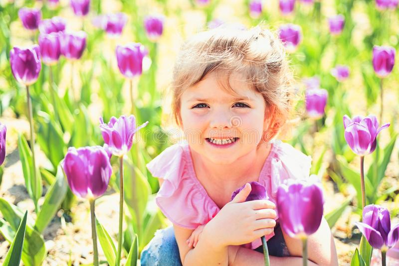 Express positivity. Small child. Natural beauty. Childrens day. Summer girl. Happy childhood. Springtime tulips. weather royalty free stock photography