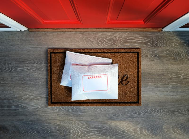 Express service envelopes delivered to door step. Overhead view. Copy space stock photos