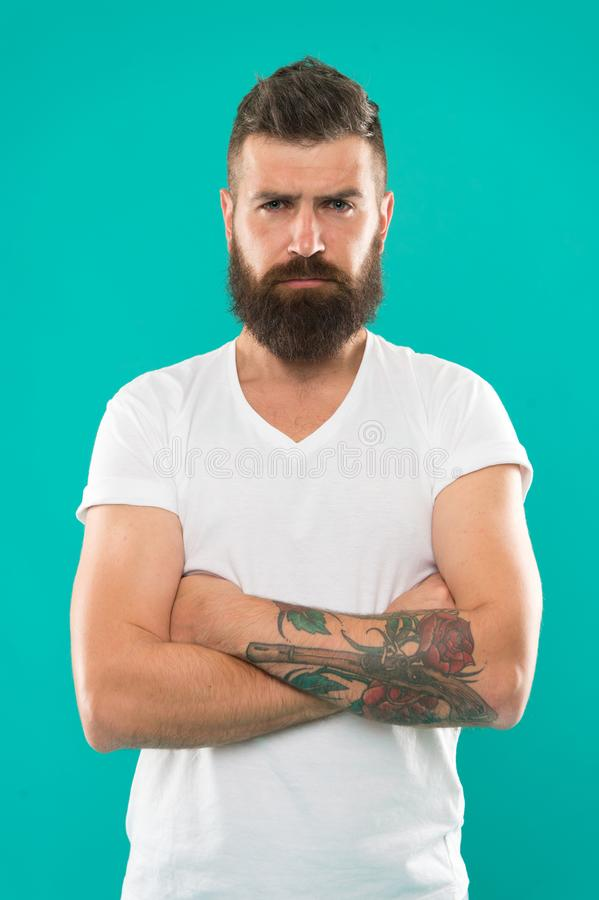 Expressing confidence. Confident man. Brutal man with long beard hair and mustache. Caucasian man with hipster beard. Bearded man with fashion haircut. To royalty free stock photo