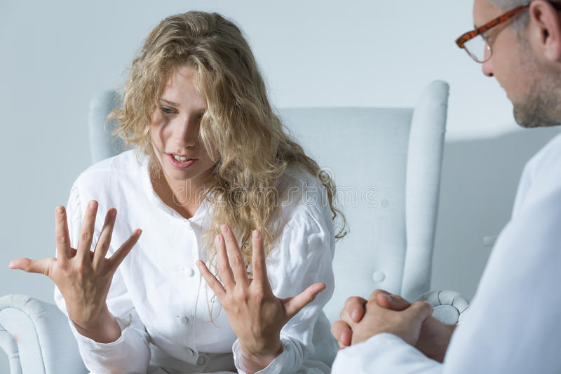 Expressing her emotions. Shot of a psychiatrist listening to her patient's talking royalty free stock photo