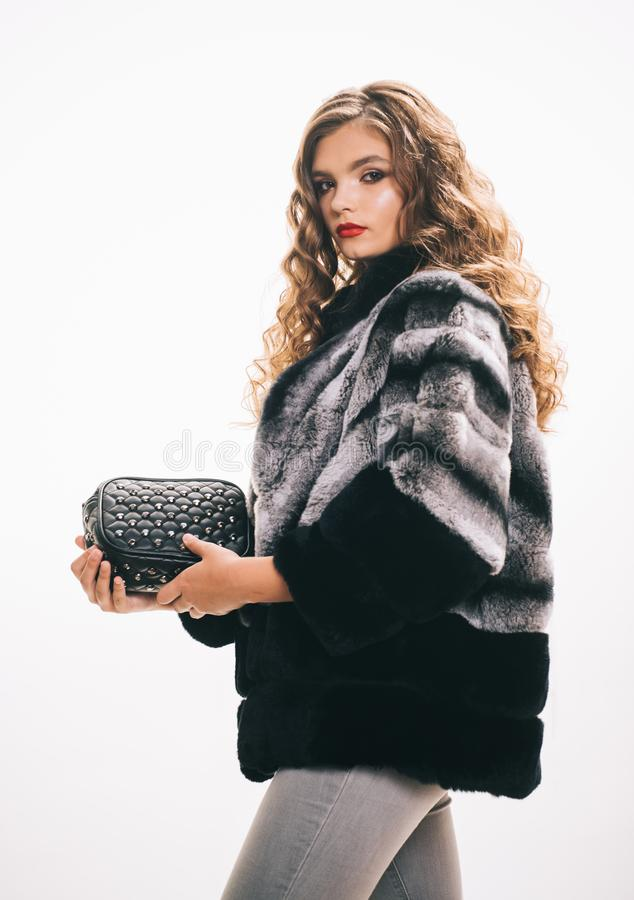 Expressing her individuality. Fashion model wear luxurious fur. Young woman wear elegant winter coat. Pretty woman in. Fashionable fur coat. Winter fashion stock photo