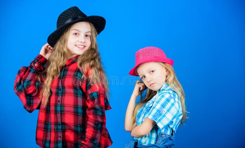 Expressing who they are from the inside. Little sisters with adorable fashion look. Small cute fashion models royalty free stock photos