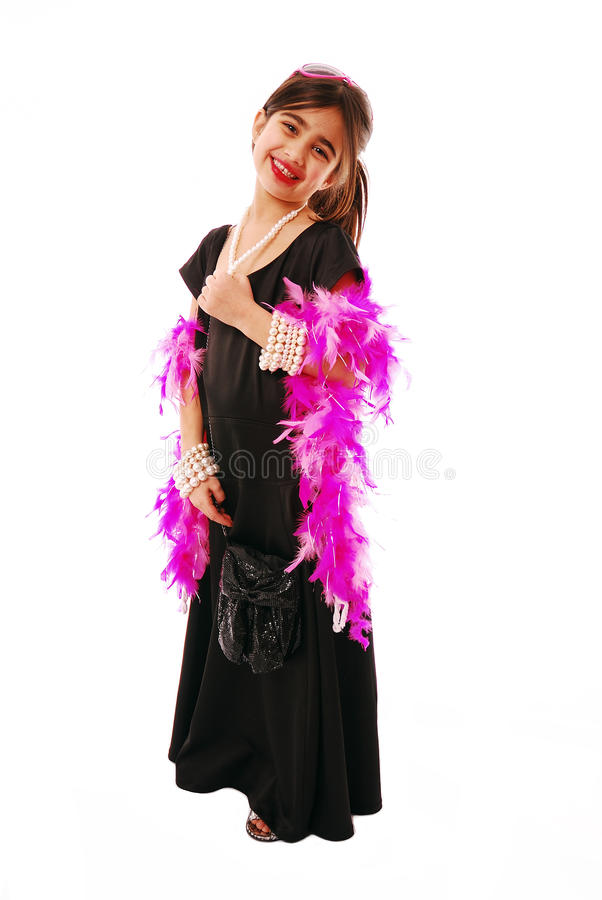 Expressing yourself. Portrait of young girl dressing up in her mothers clothes royalty free stock image