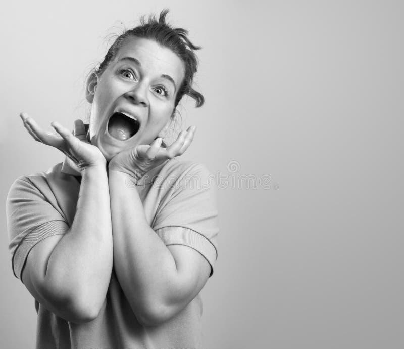 Expressio de griterío de la cara de la mujer fotografía de archivo