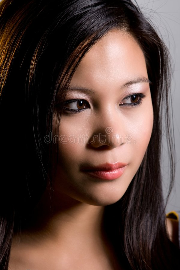 Expression. Beautiful asian showing some facial expression royalty free stock photography