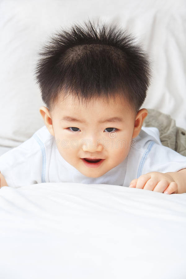 Expression of Asian toddler. Expression of playful Asian toddler at home royalty free stock images