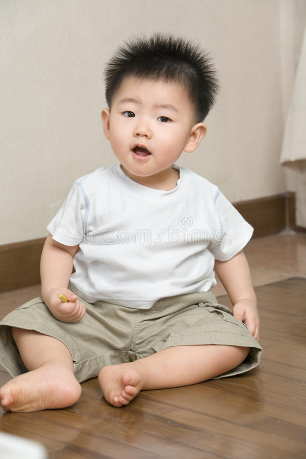 Expression of Asian toddler. Expression of playful Asian toddler at home stock photography