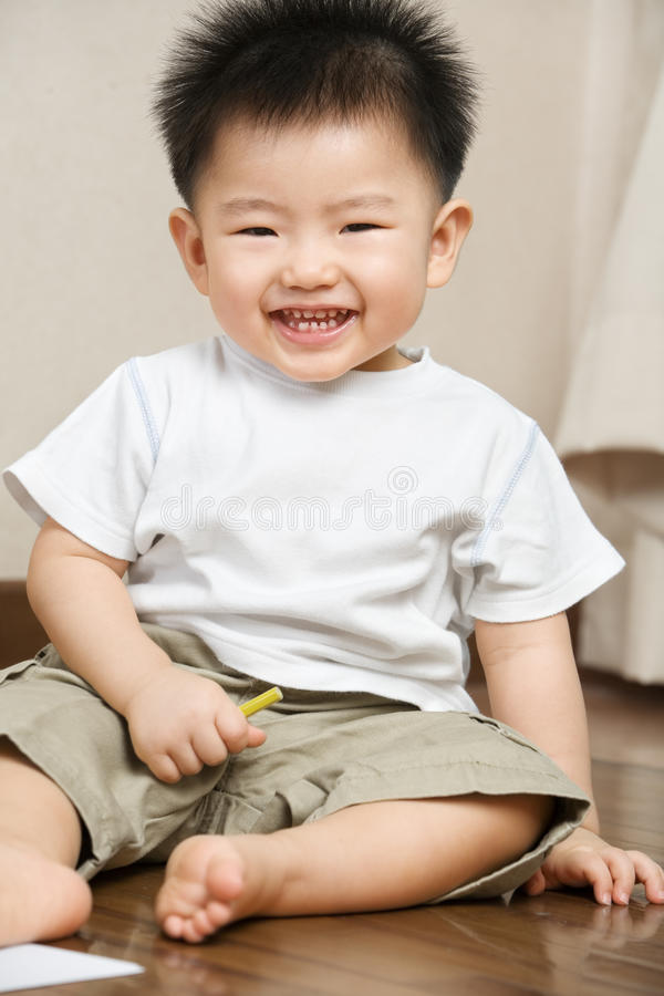 Expression of Asian toddler. Expression of playful Asian toddler at home royalty free stock photography