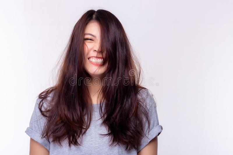 Expression concept. Charming beautiful young woman laughing and gets messy hair. Attractive beautiful girl is cheerful person. stock photography