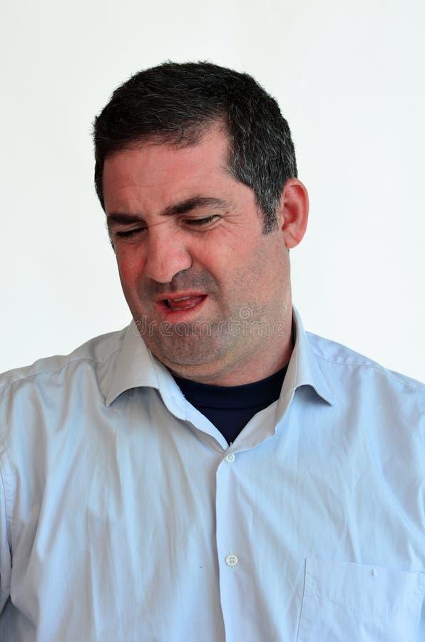 Expression de visage de dégoût d'homme photos stock