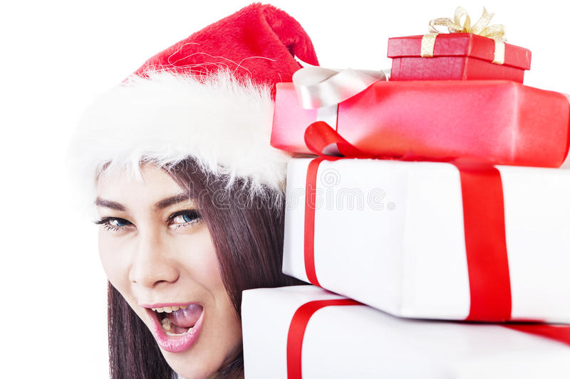 Expression of happy woman with christmas gift royalty free stock photo