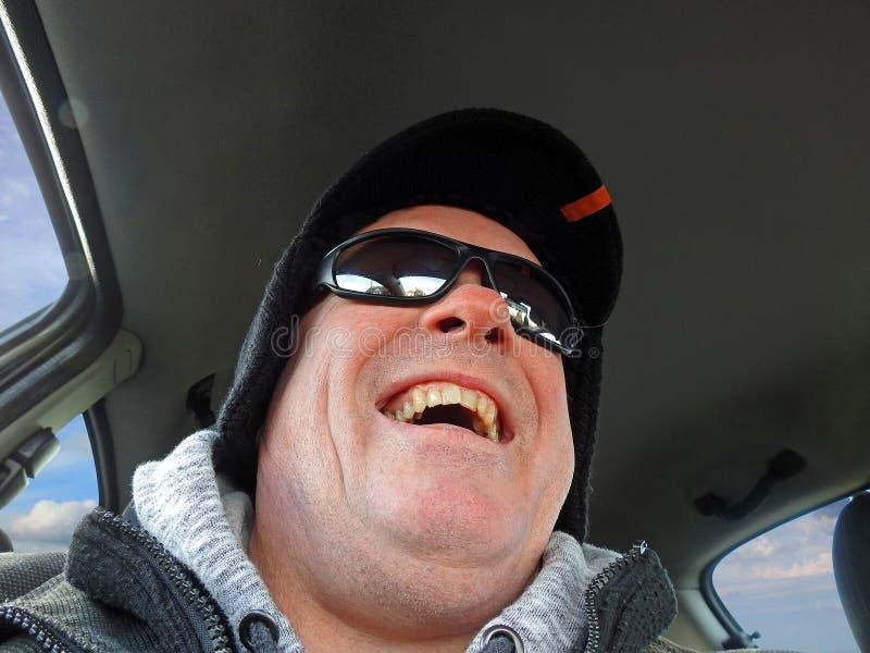 Expression heureuse de conducteur photos stock