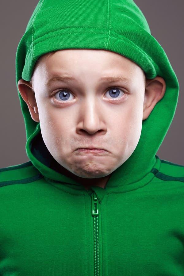 Expression little boy. enjoy grimace emotion kid royalty free stock images