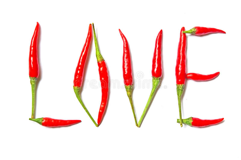 Hot and spicy Love. Expression of Love. Written using small but very spicy Red bird eye Chili stock images